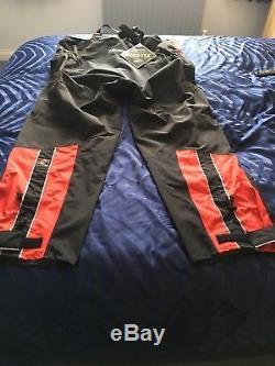 Team Daiwa Fishing Staff Gore-Tex Black&Red Jacket And Bib and Brace Trousers. XL